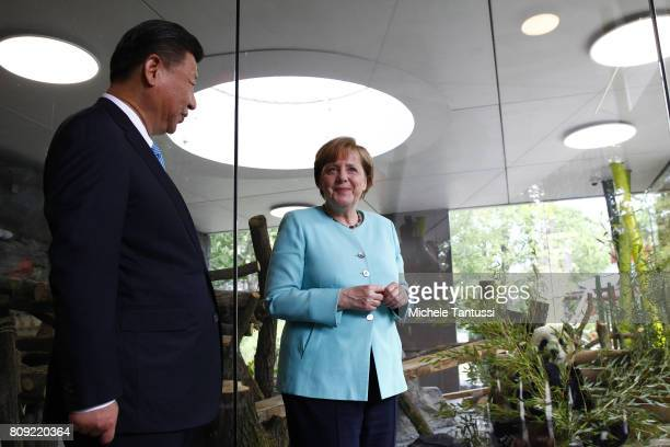 German Chancellor Angela Merkel and Chinese President Xi Jinping officially open the new panda enclosure for viewing at Zoo Berlin on July 5 2017 in...