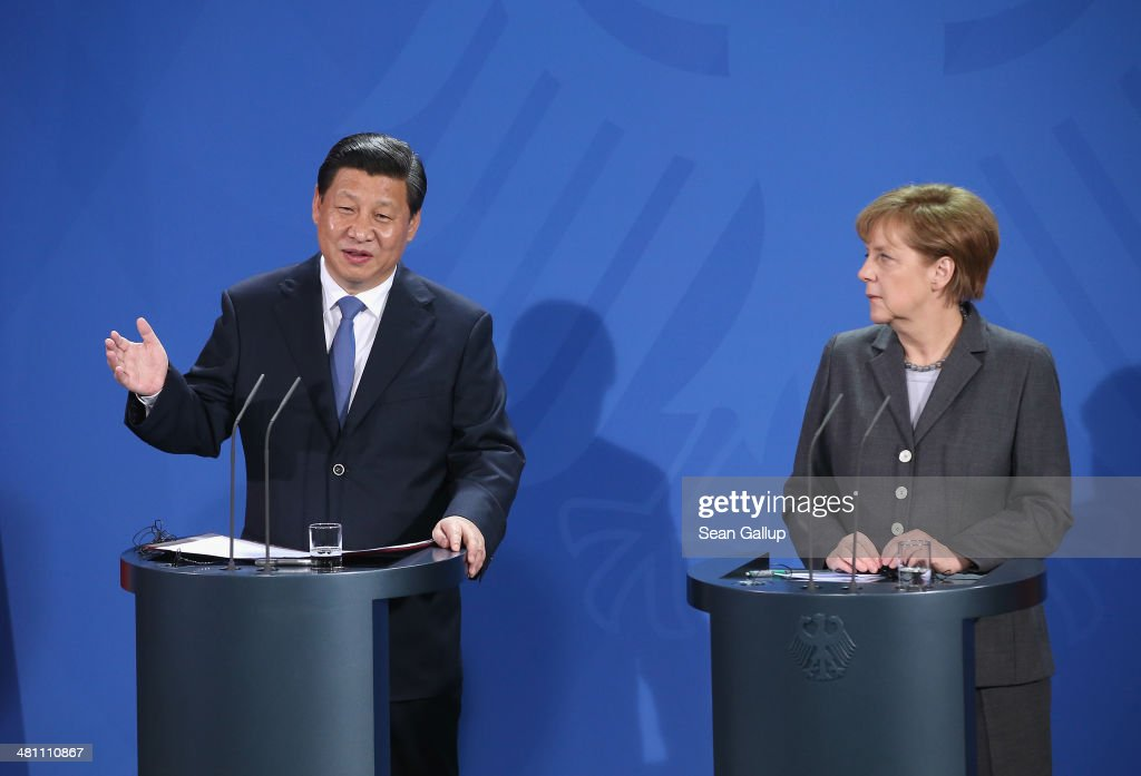 German Chancellor <a gi-track='captionPersonalityLinkClicked' href=/galleries/search?phrase=Angela+Merkel&family=editorial&specificpeople=202161 ng-click='$event.stopPropagation()'>Angela Merkel</a> and Chinese President <a gi-track='captionPersonalityLinkClicked' href=/galleries/search?phrase=Xi+Jinping&family=editorial&specificpeople=2598986 ng-click='$event.stopPropagation()'>Xi Jinping</a> speak to the media following talks at the signing of bilateral agreements at the Chancellery on March 28, 2014 in Berlin, Germany. President <a gi-track='captionPersonalityLinkClicked' href=/galleries/search?phrase=Xi+Jinping&family=editorial&specificpeople=2598986 ng-click='$event.stopPropagation()'>Xi Jinping</a> is on a two-day official visit to Germany.