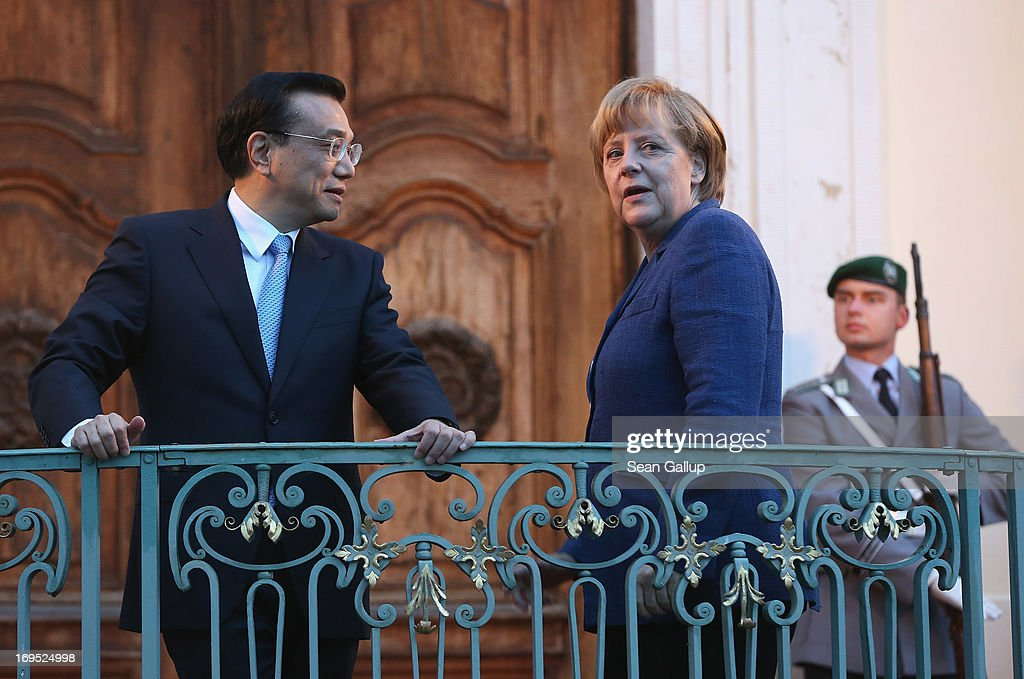 German Chancellor <a gi-track='captionPersonalityLinkClicked' href=/galleries/search?phrase=Angela+Merkel&family=editorial&specificpeople=202161 ng-click='$event.stopPropagation()'>Angela Merkel</a> and Chinese Prime Minister <a gi-track='captionPersonalityLinkClicked' href=/galleries/search?phrase=Li+Keqiang&family=editorial&specificpeople=2481781 ng-click='$event.stopPropagation()'>Li Keqiang</a> stand at the entrance to the Meseberg government guest house upon Mr. Li's arrival there for dinner on May 26, 2013 in Meseberg, Germany. On his first official visit to Germany as prime minister Mr. Li is scheduled to meet with German government officials and business representatives.