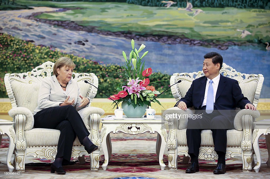 German Chancellor <a gi-track='captionPersonalityLinkClicked' href=/galleries/search?phrase=Angela+Merkel&family=editorial&specificpeople=202161 ng-click='$event.stopPropagation()'>Angela Merkel</a> (L) and Chinese Vice President <a gi-track='captionPersonalityLinkClicked' href=/galleries/search?phrase=Xi+Jinping&family=editorial&specificpeople=2598986 ng-click='$event.stopPropagation()'>Xi Jinping</a> talk during their meeting at the Great Hall of the People in Beijin on August 30, 2012 in Beijing, China. Merkel is on a two-day official visit to China.