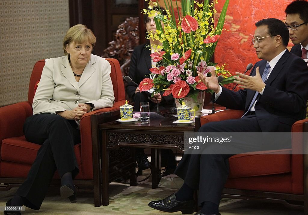 German Chancellor Angela Merkel (L) and Chinese Vice-Premier Li Keqiang chat during their meeting at the Zhongnanhai diplomatic compound in Beijing on August 30, 2012. German leader Angela Merkel is holding top-level talks on her second visit to China this year, with Europe's debt crisis taking centre stage as it begins to drag on the two global powers. Leading several ministers and a high-powered business delegation, Merkel will meet Premier Wen Jiabao in Beijing during the two-day trip and travel to an assembly plant of European planemaker Airbus in nearby Tianjin city.