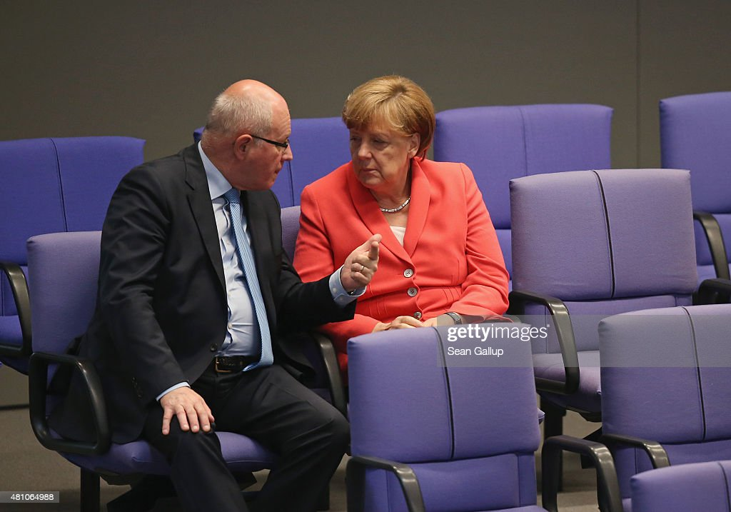German Chancellor Angela Merkel and Christian Democrats (CDU) Bundestag faction leader Volker Kauder speak with one another during debates prior to votes over the third EU financial aid package to Greece at an extraordinary session of the German parliament, the Bundestag, on July 17, 2015 in Berlin, Germany. The Bundestag is among several European parliaments that must vote on whether to allow negotations over the aid package that will help Greece to avert state bankruptcy and shore up the Greek banking system.