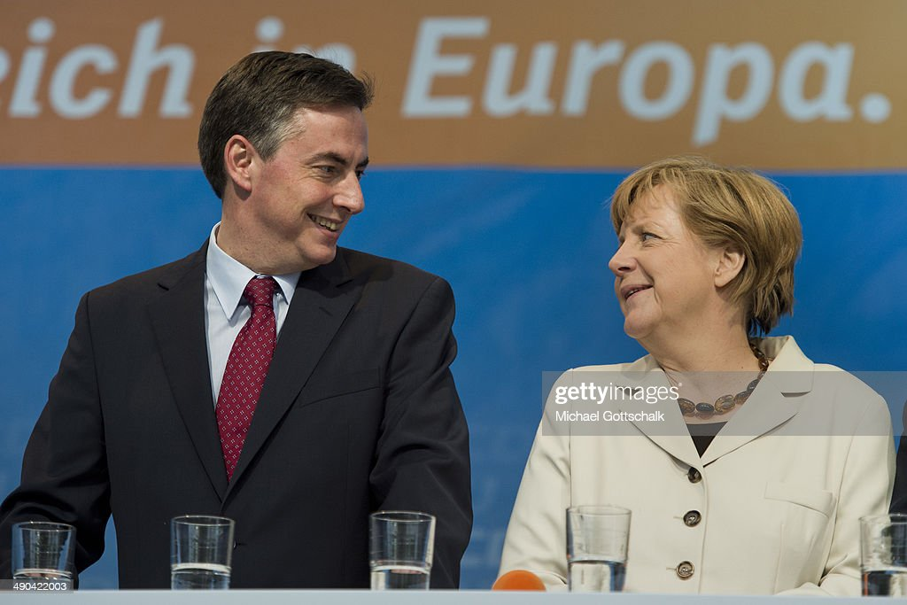 German Chancellor <a gi-track='captionPersonalityLinkClicked' href=/galleries/search?phrase=Angela+Merkel&family=editorial&specificpeople=202161 ng-click='$event.stopPropagation()'>Angela Merkel</a> and David McAllister, Candidate of German Conservative Party CDU at the elections for the European Parliament, attend a campaign at Breitscheidtplatz on May 14, 2014 in Berlin, Germany.