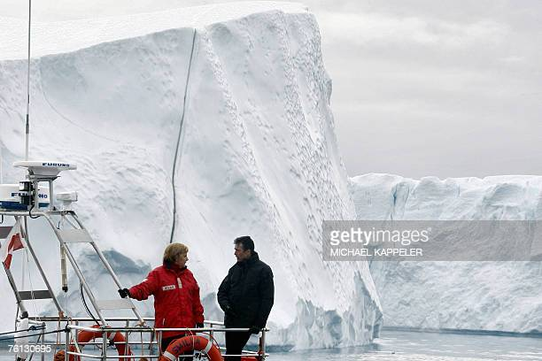 German Chancellor Angela Merkel and Denmark's Prime Minister Anders Fogh Rasmussen are pictured 16 August 2007 during a round trip on a fjord near...