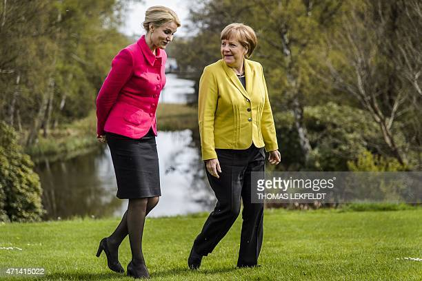 German Chancellor Angela Merkel and Denmark's Prime Minister Helle ThorningSchmidt walk at the Danish Prime Minister's official residence Marienborg...