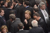 German Chancellor Angela Merkel and deputies leave after the joint session of the French National Assembly and the Bundestag at the German lower...