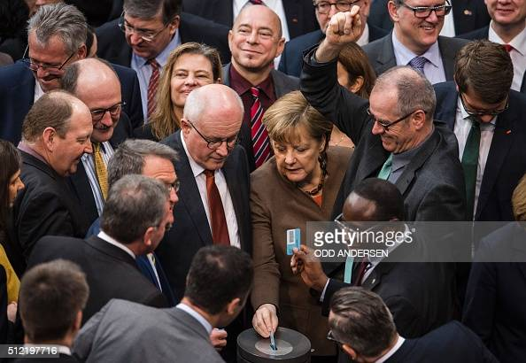German Chancellor Angela Merkel and deputies vote on a migrant bill at the Bundestag Germany's lower house of parliament in Berlin on February 25...