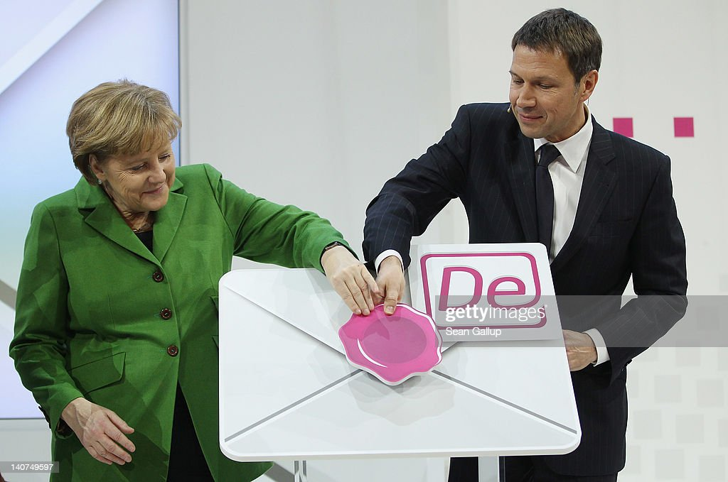 German Chancellor <a gi-track='captionPersonalityLinkClicked' href=/galleries/search?phrase=Angela+Merkel&family=editorial&specificpeople=202161 ng-click='$event.stopPropagation()'>Angela Merkel</a> and Deutsche Telekom CEO <a gi-track='captionPersonalityLinkClicked' href=/galleries/search?phrase=Rene+Obermann&family=editorial&specificpeople=655349 ng-click='$event.stopPropagation()'>Rene Obermann</a> attend a presentation of Deutsche Telekom's new De-Mail secure e-mail system on the first day of the CeBIT 2012 technology trade fair on March 6, 2012 in Hanover, Germany. CeBIT 2012, the world's largest information technology trade fair, will run from March 6-10, and advances in cloud computing and security are major features this year.