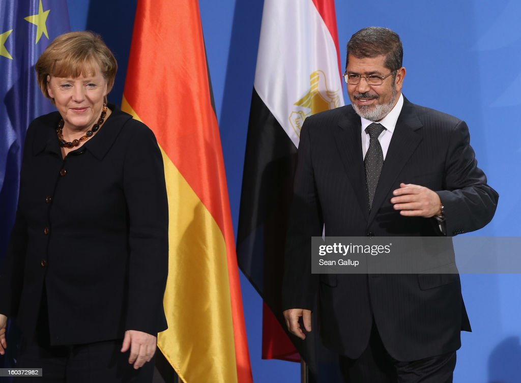 German Chancellor <a gi-track='captionPersonalityLinkClicked' href=/galleries/search?phrase=Angela+Merkel&family=editorial&specificpeople=202161 ng-click='$event.stopPropagation()'>Angela Merkel</a> and Egyptian President Mohamed Mursi depart after speaking to the media following talks at the Chancellery on January 30, 2013 in Berlin, Germany. Mursi has come to Berlin despite the ongoing violent protests in recent days in cities across Egypt that have left at least 50 people dead. Mursi is in Berlin to seek both political and financial support from Germany.