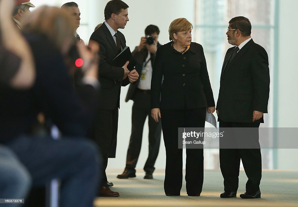 German Chancellor Angela Merkel and Egyptian President Mohamed Mursi arrive to speak to the media following talks at the Chancellery on January 30, 2013 in Berlin, Germany. Mursi has come to Berlin despite the ongoing violent protests in recent days in cities across Egypt that have left at least 50 people dead. Mursi is in Berlin to seek both political and financial support from Germany.
