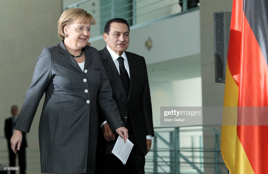 German Chancellor Angela Merkel and Egyption President <a gi-track='captionPersonalityLinkClicked' href=/galleries/search?phrase=Hosni+Mubarak&family=editorial&specificpeople=201752 ng-click='$event.stopPropagation()'>Hosni Mubarak</a> arrive to speak to the media after talks at the Chancellery (Bundeskanzleramt) on March 4, 2010 in Berlin, Germany. Mubarak is on a one-day official visit to Germany.