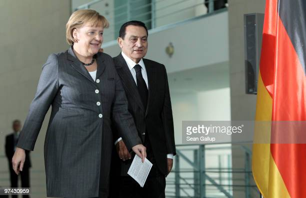 German Chancellor Angela Merkel and Egyption President Hosni Mubarak arrive to speak to the media after talks at the Chancellery on March 4 2010 in...