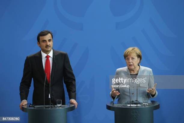 German Chancellor Angela Merkel and Emir of Qatar Sheikh Tamim bin Hamad Al Thani speak to the media following talks at the Chancellery on September...