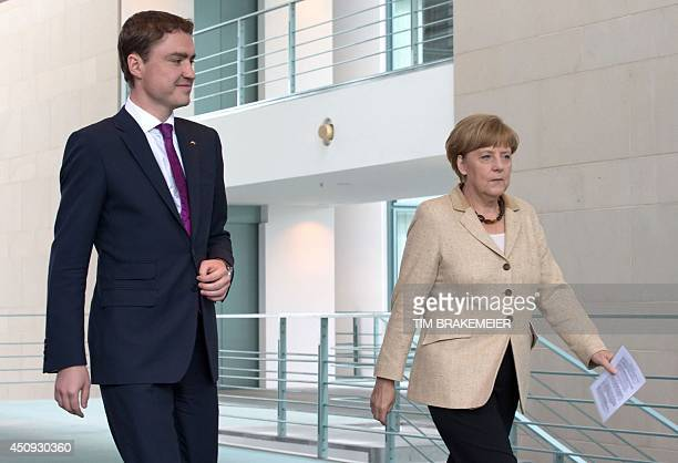 German Chancellor Angela Merkel and Estonian Prime Minister Taavi Roivas arrive for a joint press conference following talks at the Chancellery in...