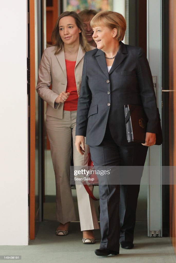 German Chancellor <a gi-track='captionPersonalityLinkClicked' href=/galleries/search?phrase=Angela+Merkel&family=editorial&specificpeople=202161 ng-click='$event.stopPropagation()'>Angela Merkel</a> and Family Minister Kristina Schroeder arrive fo the weekly German government cabinet meeting on May 30, 2012 in Berlin, Germany. High on the morning's agenda was a new law that will guarantee every pre-school child in Germany a spot in a day care center.