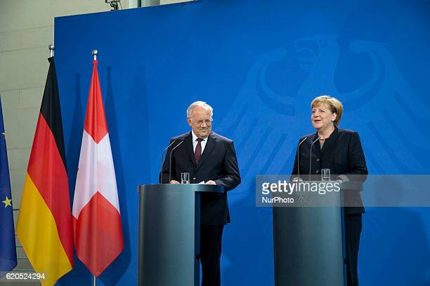 German Chancellor Angela Merkel and Federal Swiss President Johann SchneiderAmmann are pictured duirng a news conference at the Chancellery in Berlin...