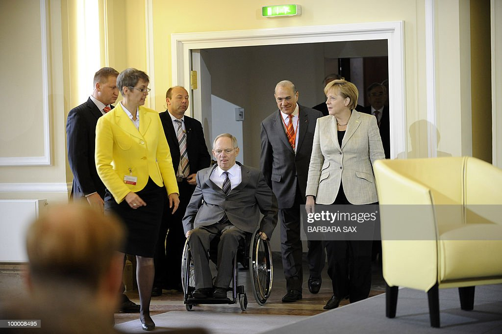 German Chancellor Angela Merkel (R) and Finance Minister Wolfgang Schaeuble (C) arrive for a conference on financial regulation on May 20, 2010 at the Finance Ministry in Berlin. Merkel said during the conference she would lead a campaign for a tax on financial markets at the next meeting of the Group of 20 developed economies in June 2010 and called for international support.