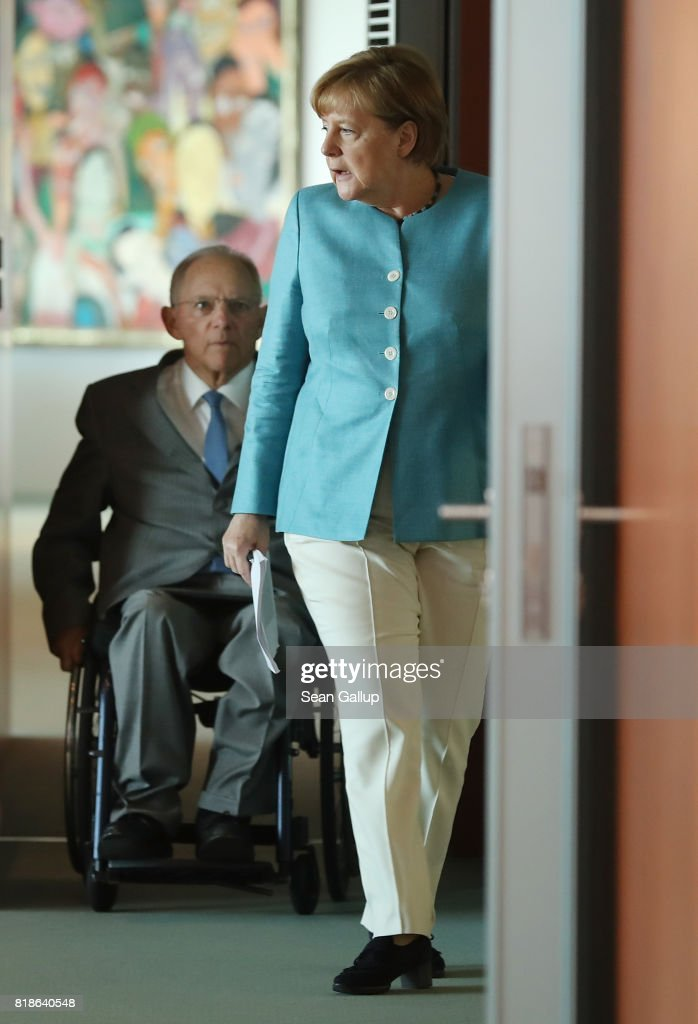 German Chancellor Angela Merkel and Finance Minister Wolfgang Schaeuble arrive for the weekly German government cabinet meeting at the Chancellery on July 19, 2017 in Berlin, Germany. Today's is the last cabinet meeting before the summer recess.