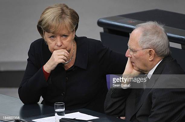 German Chancellor Angela Merkel and Finance Minister Wolfgang Schaeuble attend debates at the Bundestag after she gave a government declaration on...