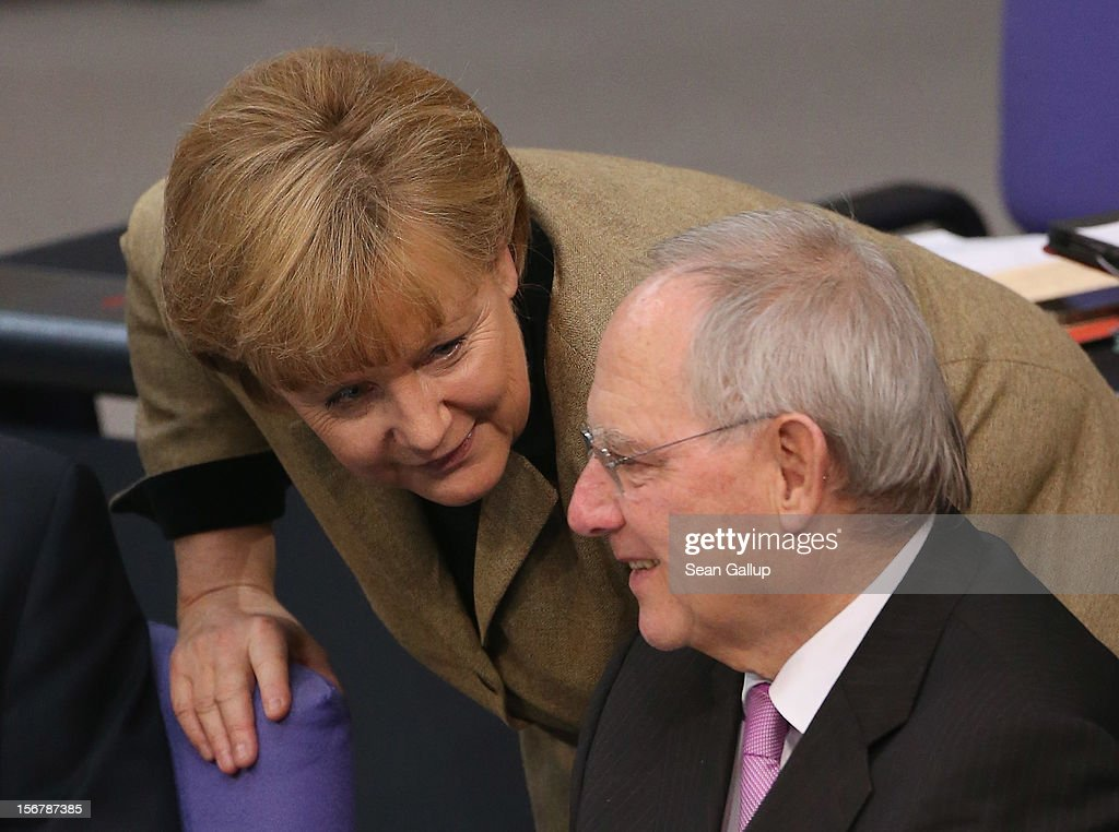 German Chancellor <a gi-track='captionPersonalityLinkClicked' href=/galleries/search?phrase=Angela+Merkel&family=editorial&specificpeople=202161 ng-click='$event.stopPropagation()'>Angela Merkel</a> and Finance Minister Wolfgang Schaeuble attend debates at the Bundestag over the 2013 federal budget on November 21, 2012 in Berlin, Germany. Bundestag members are debating the budget over four days this week.