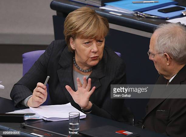 German Chancellor Angela Merkel and Finance Minister Wolfgang Schaeuble attend debates prior to a vote at the Bundestag on Germany's participation in...