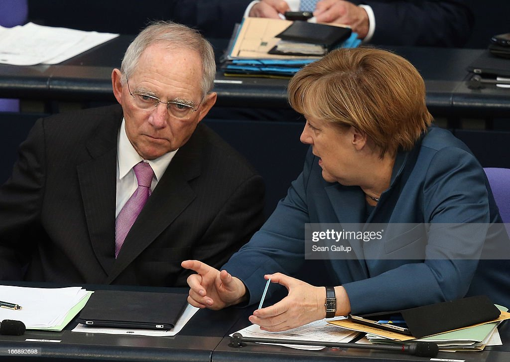 German Chancellor <a gi-track='captionPersonalityLinkClicked' href=/galleries/search?phrase=Angela+Merkel&family=editorial&specificpeople=202161 ng-click='$event.stopPropagation()'>Angela Merkel</a> and Finance Minister Wolfgang Schaeuble chat during debates over EU finanical aid to Cyprus at the Bundestag on April 18, 2013 in Berlin, Germany. The Bundestag will vote later today whether to pass ESM support for Cyprus, which will help Cyprus banks with EUR 10 biilion.