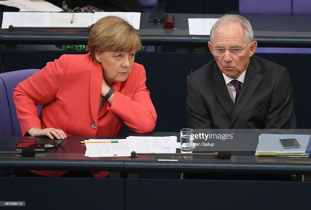 German Chancellor <a gi-track='captionPersonalityLinkClicked' href=/galleries/search?phrase=Angela+Merkel&family=editorial&specificpeople=202161 ng-click='$event.stopPropagation()'>Angela Merkel</a> and Finance Minister Wolfgang Schaeuble speak with one another during debates prior to votes over the third EU financial aid package to Greece at an extraordinary session of the German parliament, the Bundestag, on July 17, 2015 in Berlin, Germany. The Bundestag is among several European parliaments that must vote on whether to allow negotations over the aid package that will help Greece to avert state bankruptcy and shore up the Greek banking system.