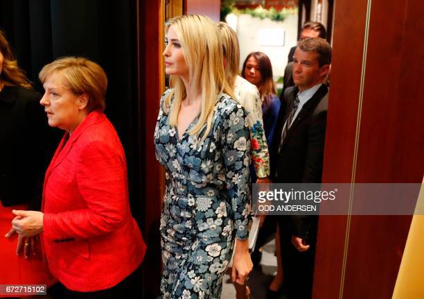 German Chancellor Angela Merkel and First Daughter and Advisor to the US President Ivanka Trump leave after a panel discussion at the W20 women's...