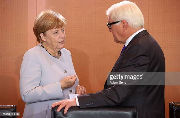 German Chancellor Angela Merkel and Foreign Minister FrankWalter Steinmeier arrive for the weekly German federal Cabinet meeting on August 31 2016 in...