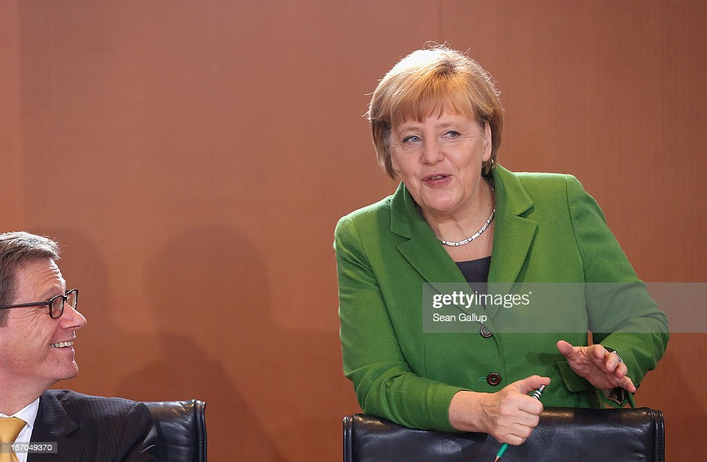 German Chancellor <a gi-track='captionPersonalityLinkClicked' href=/galleries/search?phrase=Angela+Merkel&family=editorial&specificpeople=202161 ng-click='$event.stopPropagation()'>Angela Merkel</a> and Foreign Minister <a gi-track='captionPersonalityLinkClicked' href=/galleries/search?phrase=Guido+Westerwelle&family=editorial&specificpeople=208748 ng-click='$event.stopPropagation()'>Guido Westerwelle</a> arrive for the weekly German government cabinet meeting on November 28, 2012 in Berlin, Germany. High on the morning's agenda was changes to the country's pension system.