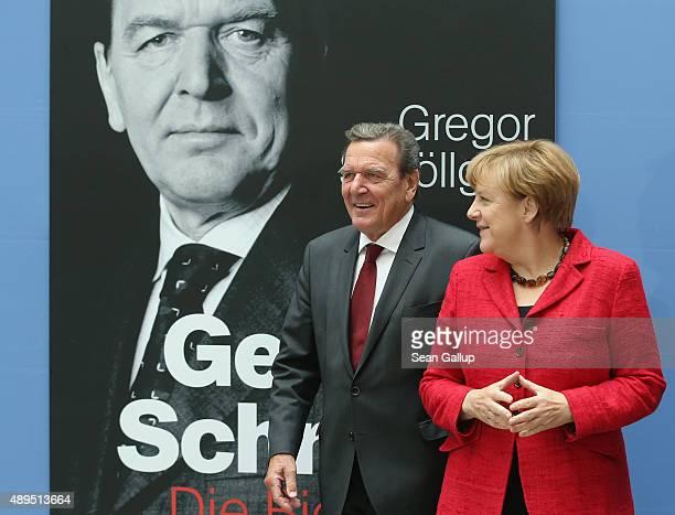 German Chancellor Angela Merkel and former Chancellor Gerhard Schroeder arrive for the presentation of Schroeder's biography on September 22 2015 in...
