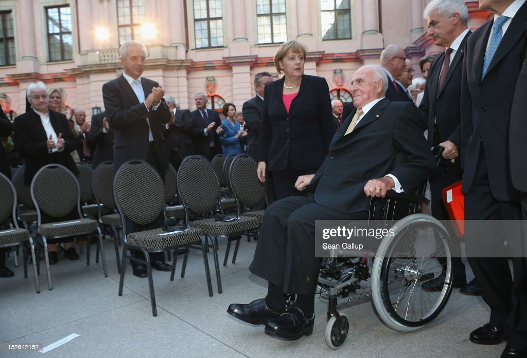 German Chancellor Angela Merkel and former German Chancellor Helmut Kohl arrive at a gala evening in Kohl's honour at the Deutsches Museum on...