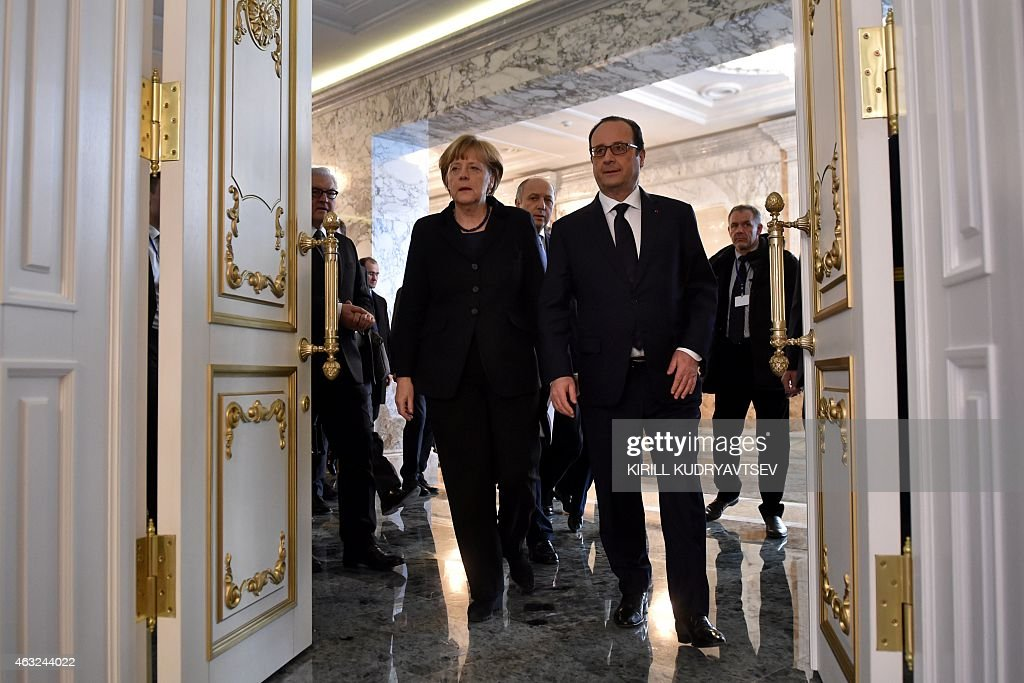 German Chancellor Angela Merkel and France's President Francois Hollande arrive for a briefing after a summit aimed at ending 10 months of fighting...
