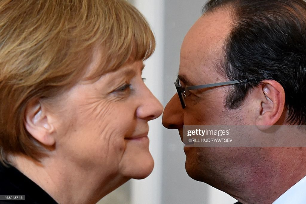 German Chancellor Angela Merkel and France's President Francois Hollande take part in a press conference after a summit aimed at ending 10 months of...