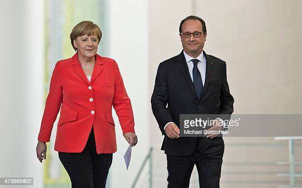 German Chancellor Angela Merkel and Francois Hollande President of France attend a press conference in german chancellery on May 19 2015 in Berlin...