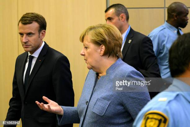 German Chancellor Angela Merkel and French president Emanuel Macron arrive for bilateral talks during the UN Climate Change Conference COP23 on...