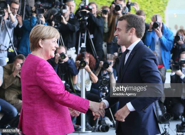 German Chancellor Angela Merkel and French President Emmanuel Macron shake hands during their meeting in Berlin Germany on May 15 2017