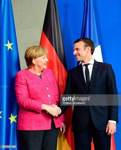 German Chancellor Angela Merkel and French President Emmanuel Macron shake hands after a joint press conference on May 15 2017 at the chancellery in...