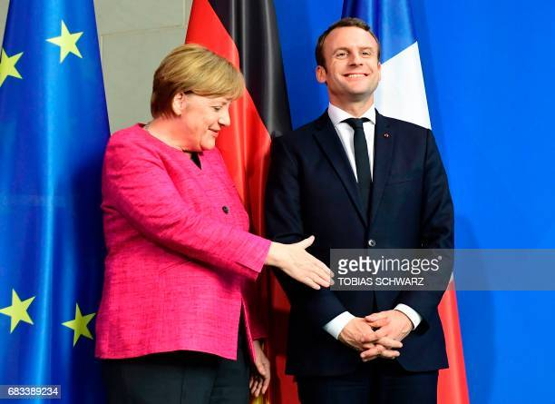 German Chancellor Angela Merkel and French President Emmanuel Macron share a lough after a joint press conference on May 15 2017 at the chancellery...