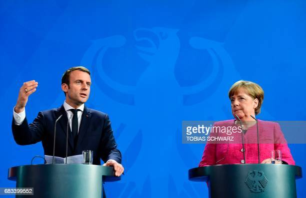 German Chancellor Angela Merkel and French President Emmanuel Macron address a joint press conference after their talks on May 15 2017 at the...