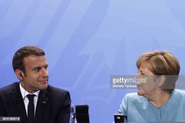 German Chancellor Angela Merkel and French President Emmanuel Macron attend a Press conference after a meeting of European Union leaders at the...