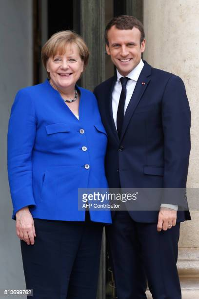German Chancellor Angela Merkel and French President Emmanuel Macron pose at the Elysee Palace in Paris on July 13 2017 ahead of an annual...