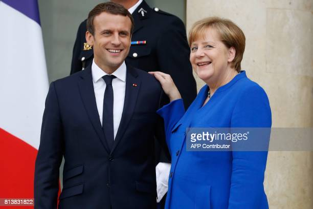 German Chancellor Angela Merkel and French President Emmanuel Macron leave the Elysee Palace in Paris on July 13 after an annual FrancoGerman Summit...