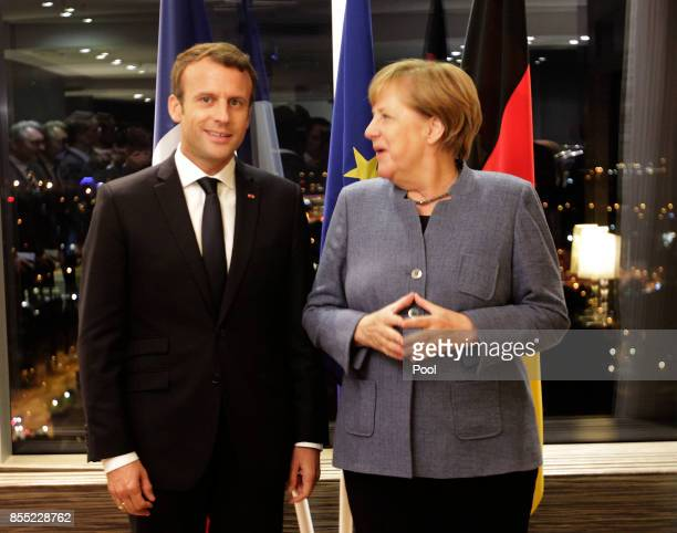 German Chancellor Angela Merkel and French President Emmanuel Macron talk together during a meeting at the Tallinn Digital Summit on September 28...