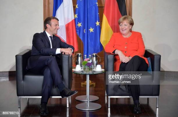 German Chancellor Angela Merkel and French President Emmanuel Macron sit down for bilateral talks while attending the opening of the Frankfurt Book...