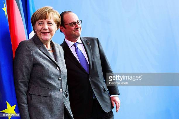 German Chancellor Angela Merkel and French President Francois Hollande after a press conference at the Chancellery on March 31 2015 in Berlin Germany...