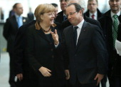 German Chancellor Angela Merkel and French President Francois Hollande arrive at the Chancellery during the 50th anniversary celebration of the...
