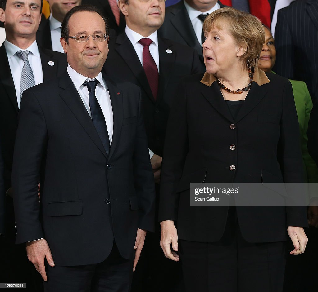 German Chancellor <a gi-track='captionPersonalityLinkClicked' href=/galleries/search?phrase=Angela+Merkel&family=editorial&specificpeople=202161 ng-click='$event.stopPropagation()'>Angela Merkel</a> and French President Francois Hollande arrive for a group photo of the French and German government members at the Chancellery during the 50th anniversary celebration of the Elysee Treaty on January 22, 2013 in Berlin, Germany. The treaty, concluded in 1963 by Charles de Gaulle and Konrad Adenauer in the Elysee Palace in Paris, set a new tone of reconciliation between France and Germany, and called for consultations between the two countries to come to a common stance on policies affecting the most important partners in Europe as well as the rest of the region. Since its establishment, the document for improved bilateral relations has been seen by many as the driving force behind European integration.