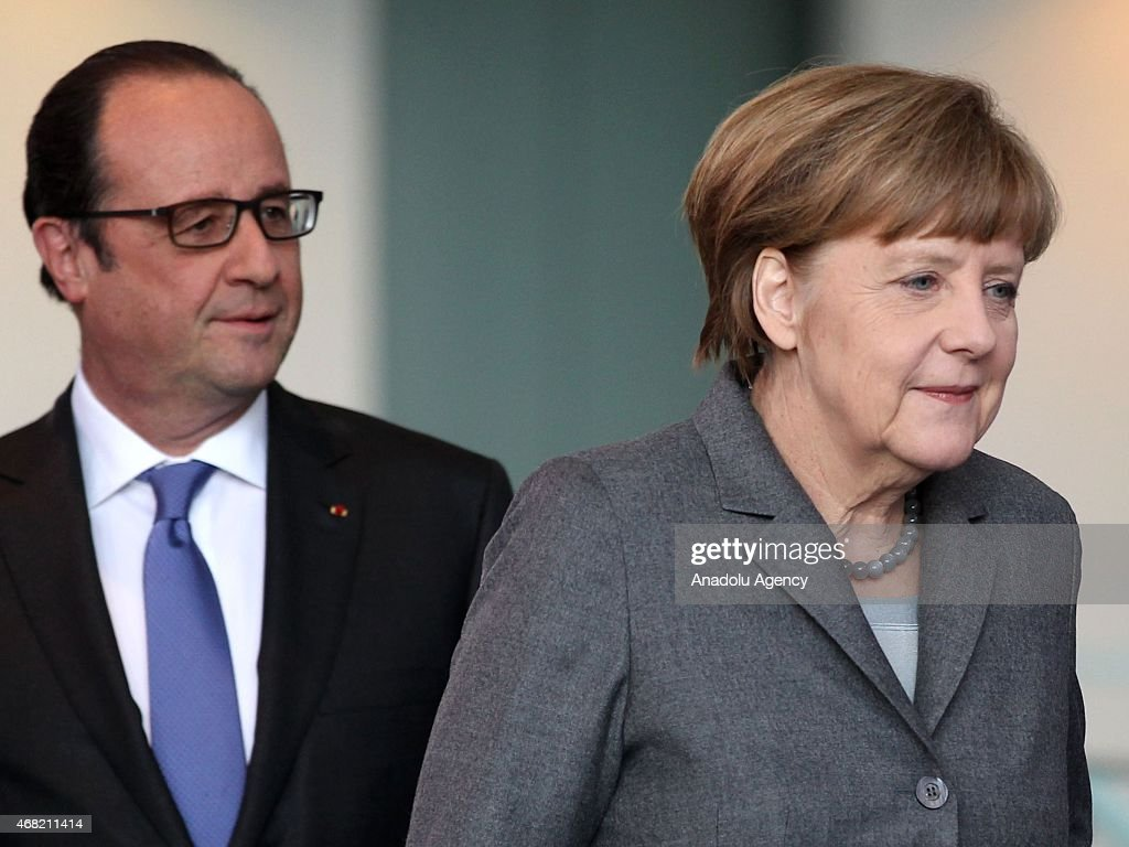 German Chancellor Angela Merkel (R) and French President Francois Hollande arrive for a press conference at the Chancellery on March 31, 2015 in Berlin, Germany. The German and French governments, including their entire cabinets, had a meeting in Berlin.