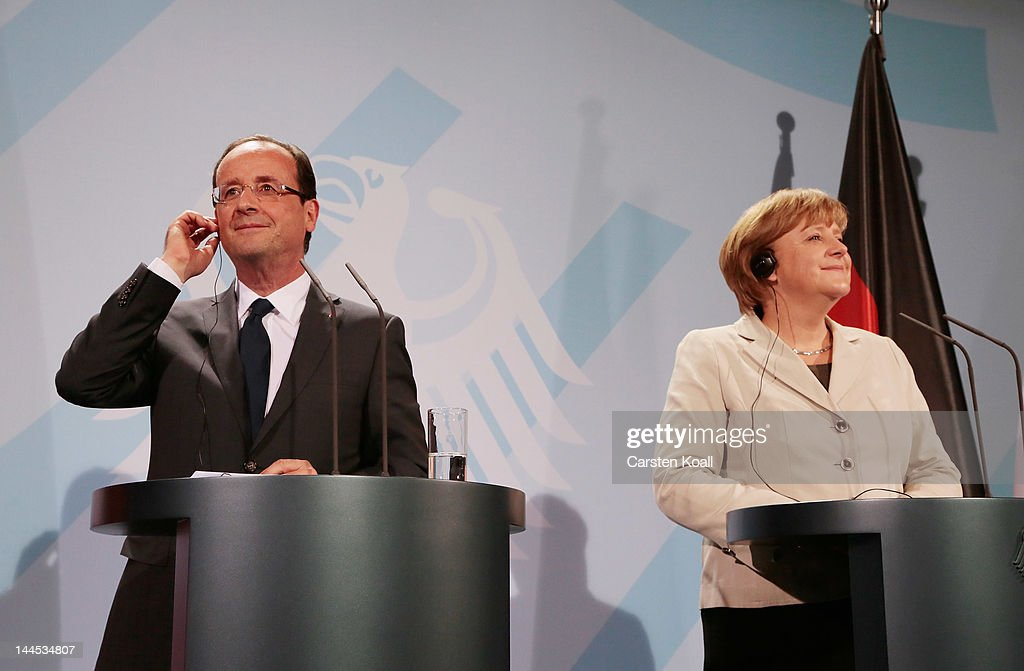 German Chancellor <a gi-track='captionPersonalityLinkClicked' href=/galleries/search?phrase=Angela+Merkel&family=editorial&specificpeople=202161 ng-click='$event.stopPropagation()'>Angela Merkel</a> (R) and French President Francois Hollande (L) attend a joint press conference at the Chancellery, hours after Hollandes inauguration in Paris, on May 15, 2012 in Berlin, Germany. Hollande has come to Berlin to discuss the current European debt crisis with Merkel and most importantly to find common ground, as he hopes to resolve the crisis with measures that mark a departure from the austerity packages favoured by Merkel.